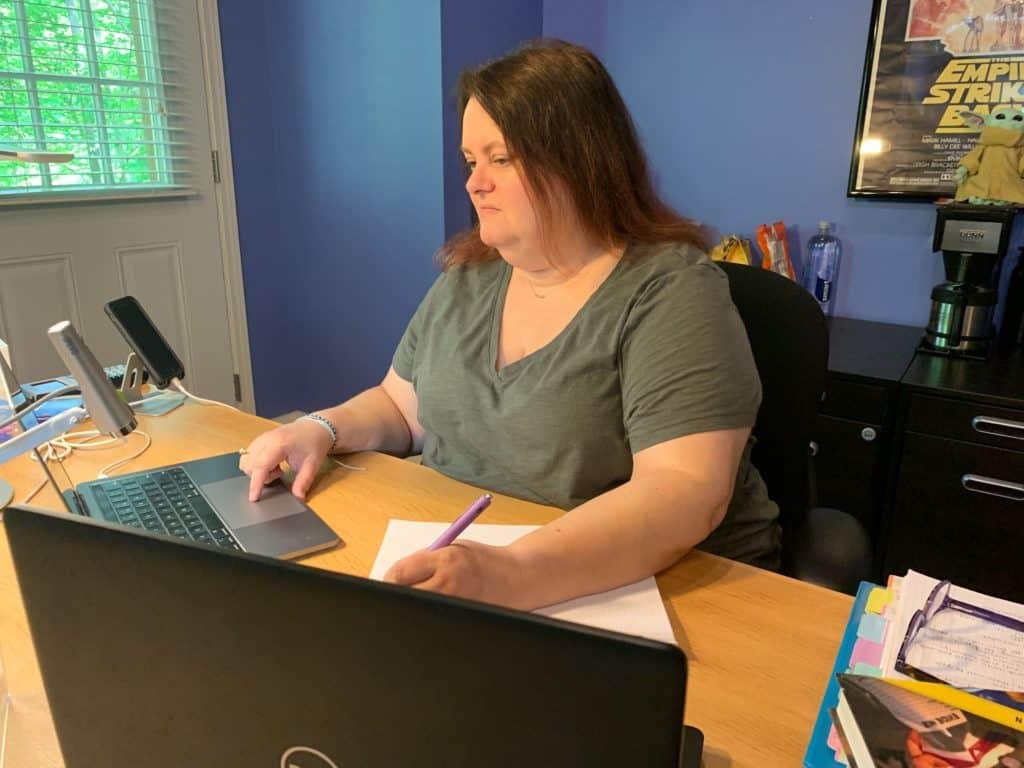 Kara at her desk